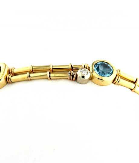 Armband in geel goud met kleurstenen en diamant