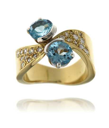 Toi et Moi geelgouden ring met topazen en briljanten
