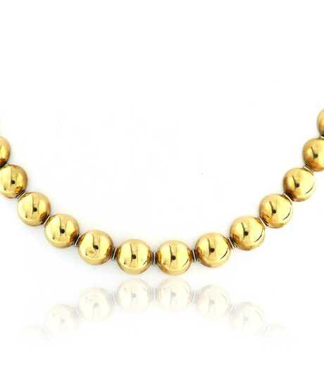 Gouden halsketting met halve bollen